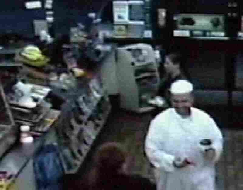 A frame grab from a security video shows suspected shooter Maj. Nidal Malik Hasan in a convenience store in Killeen, Texas, early Thursday morning, before the attack. Hasan, an Army psychiatrist, was unconscious and on a ventilator Friday, contrary to early reports that he had been killed.