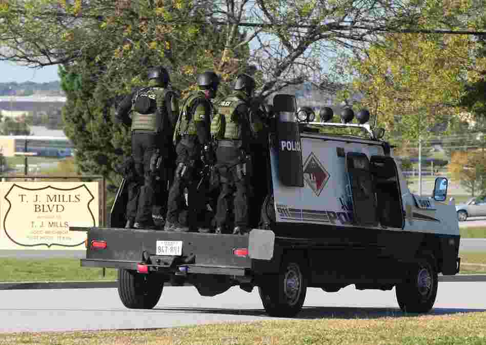A SWAT team enters the main gate at Fort Hood. The shooting occurred at the Soldier Readiness Center, where troops deploying to Iraq and Afghanistan receive last-minute medical checkups.