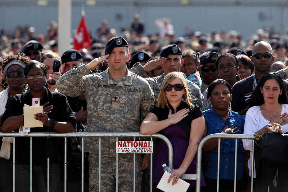 Mourners attend the memorial service Tuesday in honor of 13 victims of the shooting rampage in Fort Hood, Texas.