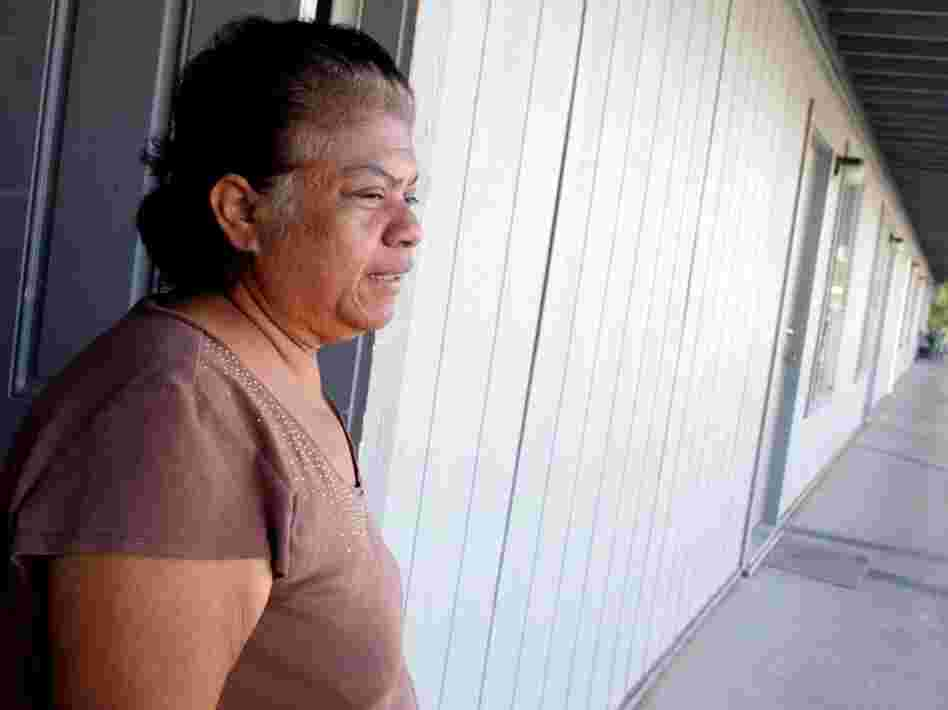 Patricia Villa, next-door neighbor to Hasan, stands in her apartment doorway in Killeen. A day before Hasan allegedly went on a shooting spree at the Fort Hood Army Base, he gave Villa furniture, clothing and a copy of the Quran.