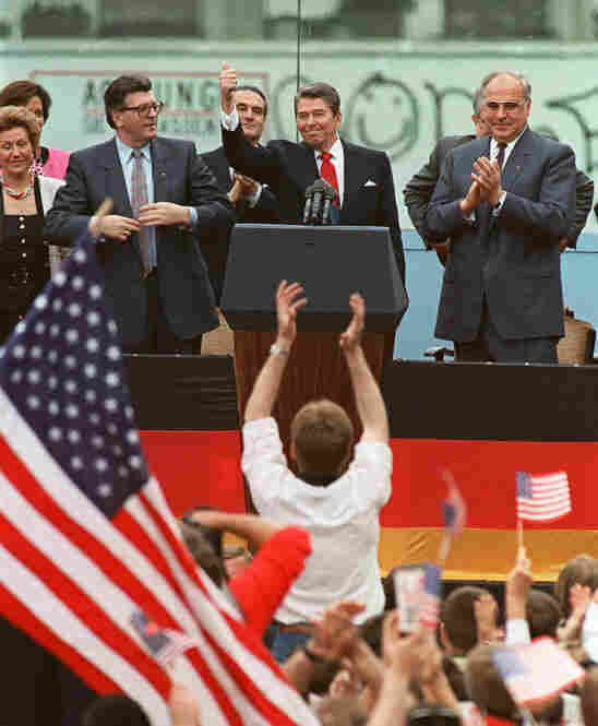 """President Reagan gives a thumbs-up sign after his speech in front of the Brandenburg Gate in West Berlin. In Reagan's iconic speech on June 12, 1987, he said, """"Mr. Gorbachev, tear down this wall!"""""""