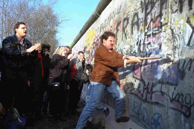 An unidentified West Berliner swings a sledgehammer at the wall near Potsdamer Platz, on Nov. 12, 1989.
