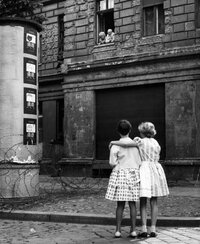 The Berlin Wall did not only divide a city; in many cases it split families. In this photo taken on Aug. 14, 1961, two children in a West Berlin street speak with their grandparents through their window in East Berlin.