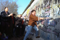 An unidentified West Berliner swings a sledgehammer at the wall near Potsdamer Platz, on Nov. 12, 1989.