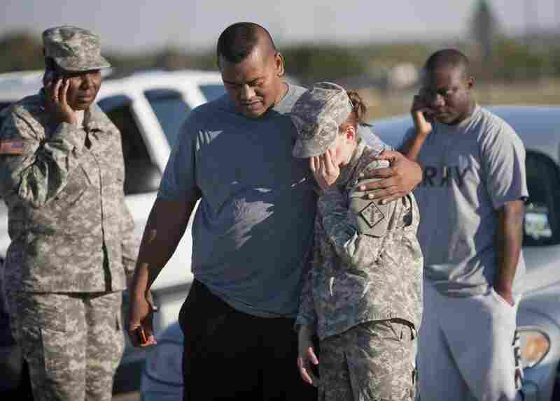 Sgt. Fanuaee Vea (center) embraces Pvt. Savannah Green outside the base.