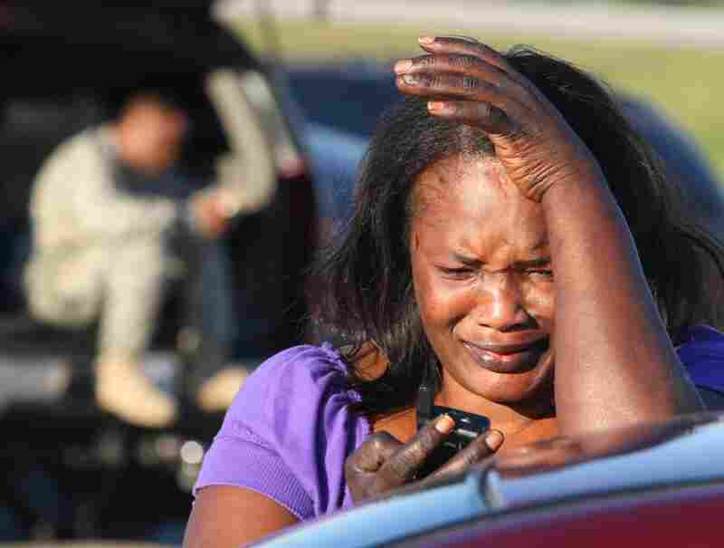 Monica Cain, 44, tries to get in touch with her husband, Sgt. Darren Cain, who is stationed at Fort Hood.