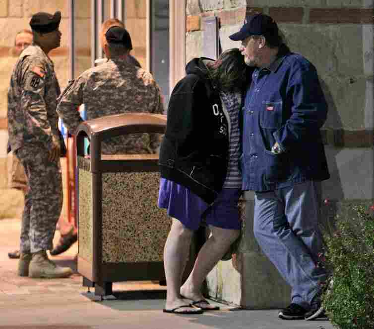 Jamie Casteel and her husband, Scotty, of Duncan, Okla., wait to hear news about their son-in-law Thursday outside the Scott and White Hospital emergency room in Temple, Texas.