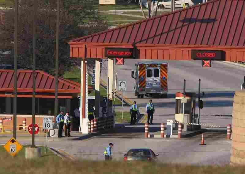 An ambulance passes the main gate at Fort Hood following the shooting.