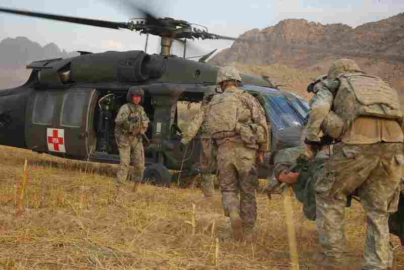 An Army Medevac team based at Kandahar Airfield, south of the Arghandab Valley, loads the casualties to transport them to a hospital.