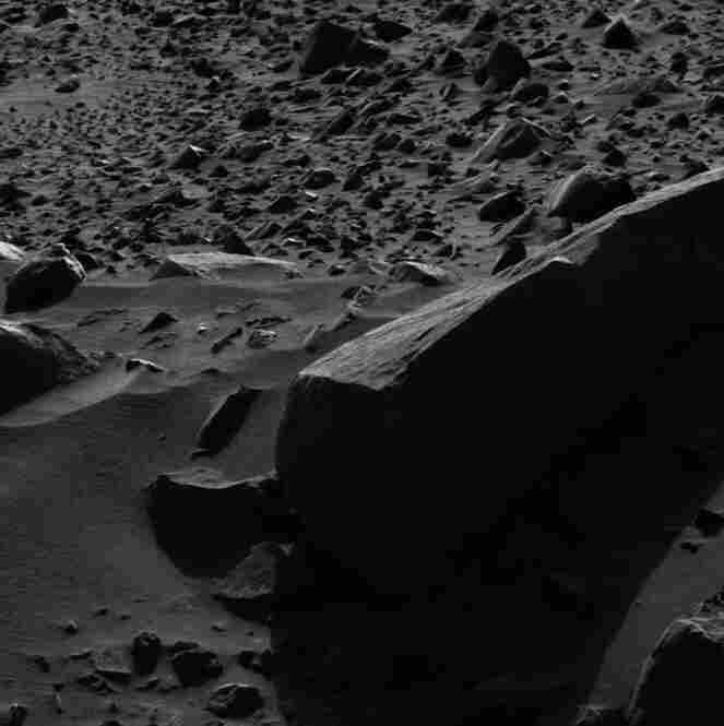 NASA's Spirit rover found an angular piece of volcanic lava that proves to be a great choice for a photographic study of Martian light and shadow.