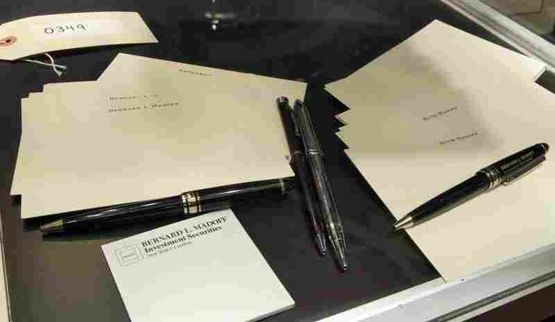 "The personalized paper stationery of Bernard Madoff and his wife Ruth Madoff, along with pens showing the logo ""Bernard L. Madoff Investment Securities."""