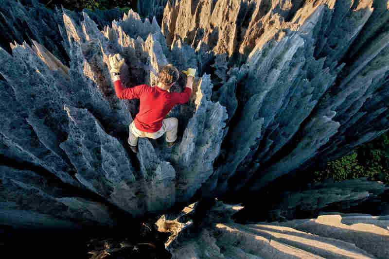 """Climber John """"Razor Sharp"""" Benson weaves through stone pinnacles. In Malagasy, these formations are called tsingy, meaning """"where one cannot walk barefoot."""""""