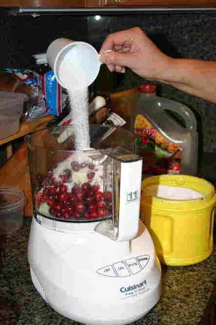 Combine cranberries, onion and sugar in a food processor.