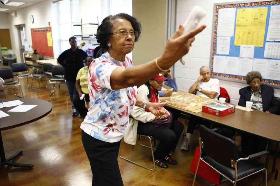 Willa Mae Graham, 81, competes in a Wii bowling game at the Langston-Brown Senior Center in Arlington, Va. The interactive video game has gained popularity among seniors, bringing them together for socializing and