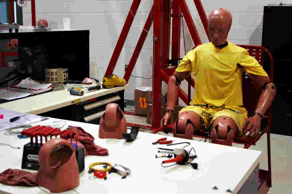 A crash test dummy sits at a workstation inside the Insurance Institute for Highway Safety's Vehicle Research Center in Ruckersville, Va. The IIHS crashes on average two vehicles per week.