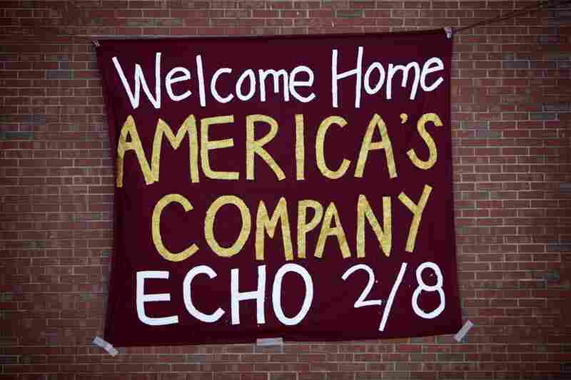 A sign on the side of Echo Company's barracks heralds the men's return.