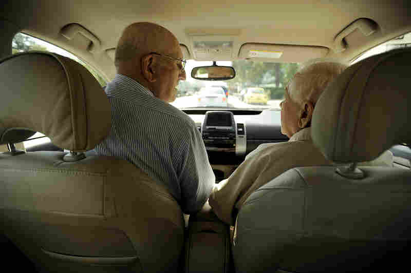 Seymour keeps the conversation light and friendly when driving passengers around the neighborhood. Here, he chats with ITN client William Gruner, 83, as they prepare to drive to a doctor's appointment.