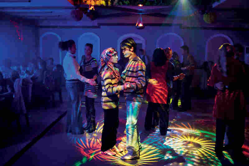 "The nightlife at a Uighur disco in Hotan attracts young couples. China scholar James Millward says that Uighurs in the cities are ""modern and worldly."" Many Uighurs also fight for the separatist cause."