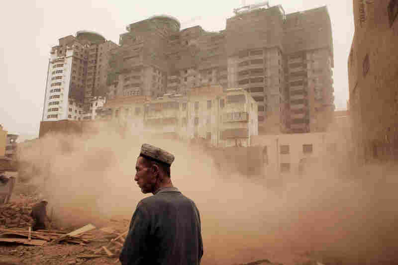 Kashgar's Old City, a center of Uighur life, is being slowly demolished by the Chinese government. Claiming that the mud-brick structures are unsafe in the case of an earthquake, officials clear space for new high-rises.