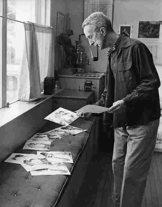 Although Kalischer pursued his own career in photography and has exhibited around the world, he continued to help Rockwell through the years. Here, Rockwell reviews images in his studio in Stockbridge. Upward of 100 photographs were shot for every illustration.