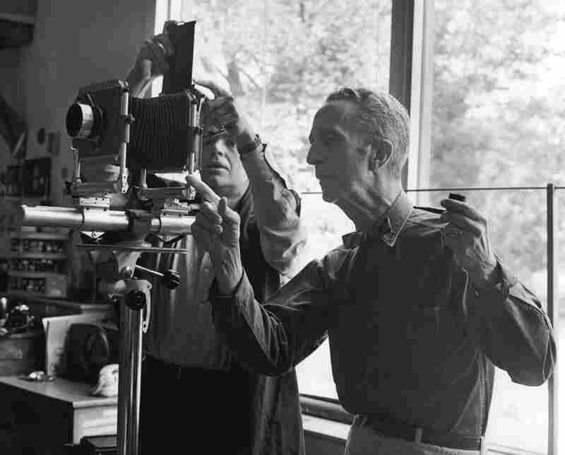 Norman Rockwell, although known in popular culture as a painter, never referred to himself as an artist, but rather as an illustrator. From behind the camera, he had the meticulous eye of a film director, as almost all of his works were traced from photographs. Here, he works with photographer Bill Scoville.