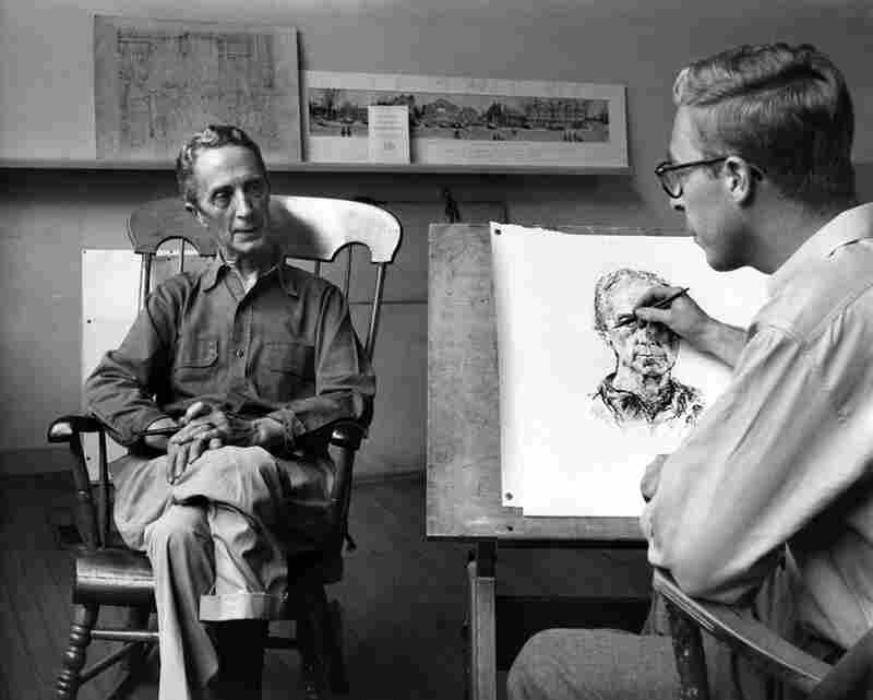 Rockwell sits as his son Jarvis draws a portrait in Stockbridge, circa 1960s.