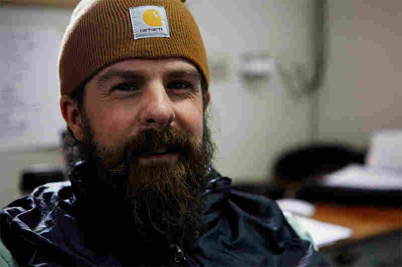 Geologist David Barbeau in his lab aboard the Laurence M. Gould. Barbeau is leading an expedition to the Antarctic Peninsula to analyze rocks and sediments. This information will help pinpoint when the Drake Passage was created.