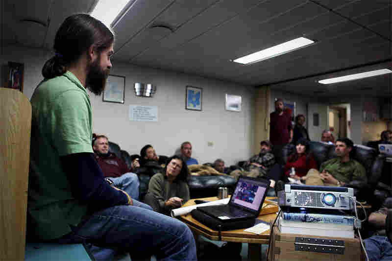 In evenings on the ship, researchers give presentations about their research to their colleagues and crew members. Here, Dave Barbeau discusses the formation of the Drake Passage and its possible impact on the climate of Antarctica.