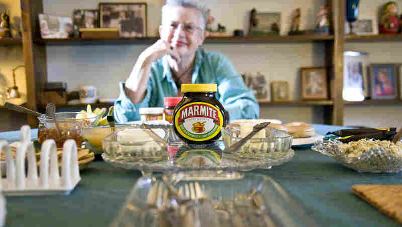 Marmite, a viscous spread made from yeast extract, provokes strong reactions from fans and foes alike. Maggie Hall is a British native and the author of The Mish-Mash Dictionary of Marmite, An Anecdotal A-Z. Here, she poses in her Washington home with an array of Marmite snacks.