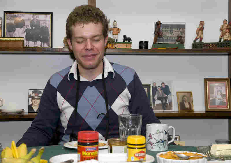 Producer Travis Larchuk grimaces after his first taste of Marmite on toast.