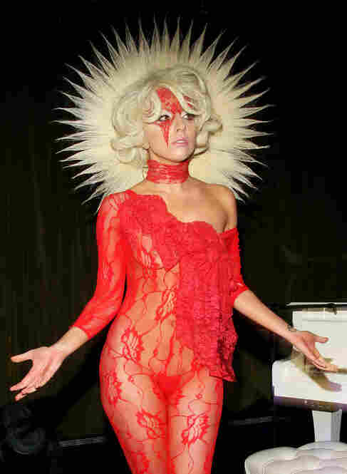 Many describe Lady Gaga's wadrobe as performance art rather than clothing. Here, she sports a lace dress and a mane-like collar at the launch of V61 on Sept. 14 in New York City.