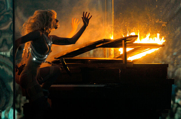 Lady Gaga is notorious for extreme performances and outfits. Here, she lights her piano on fire while performing Nov. 22 at the American Music Awards in Los Angeles, Calif.  (Getty Images)