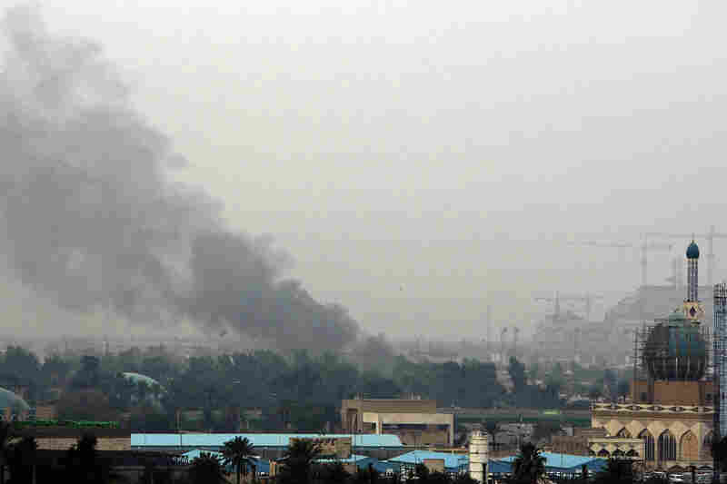 Smoke billows from the center of the Iraqi capital on Tuesday. The blasts are the most violent insurgent attacks to hit Baghdad since a pair of car bombs struck near government offices on Oct. 25, 2009.