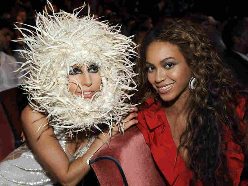 In her fourth costume change of the evening, Lady Gaga shows off a white dress and furry headpiece alongside Beyonce.