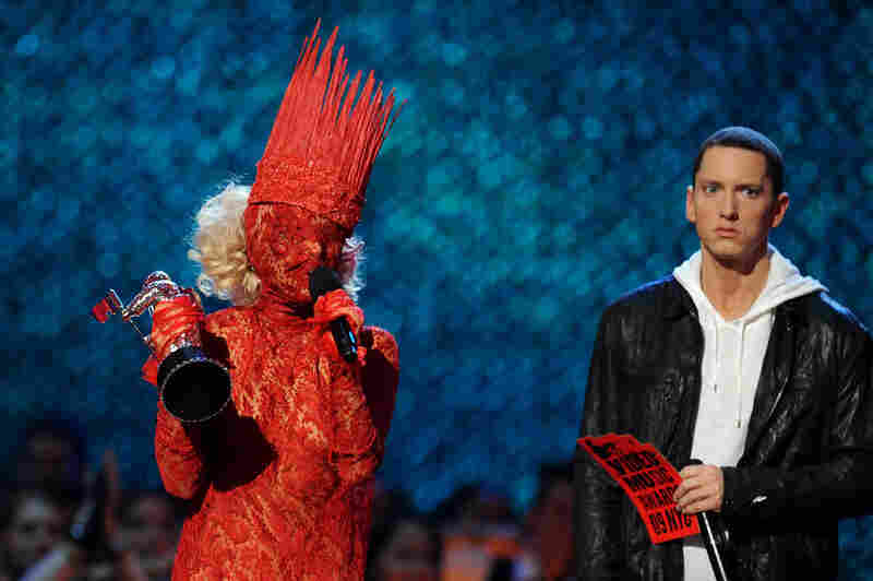 In a sheer lace dress and crown, Lady Gaga accepts her award for Best New Artist from Eminem at the VMAs.