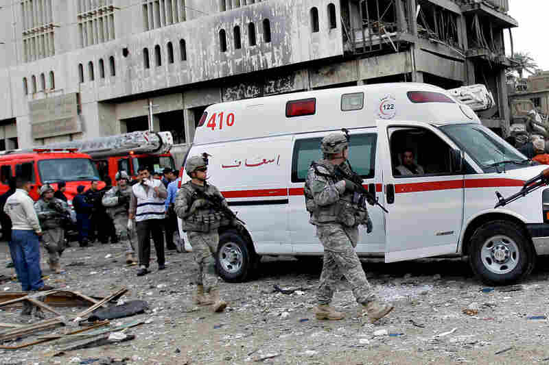 The U.S. military dispatched troops and forensics equipment following the explosions. Tuesday's attacks once more bring into question whether the Iraqi government is able to fulfill its role in providing front-line security.