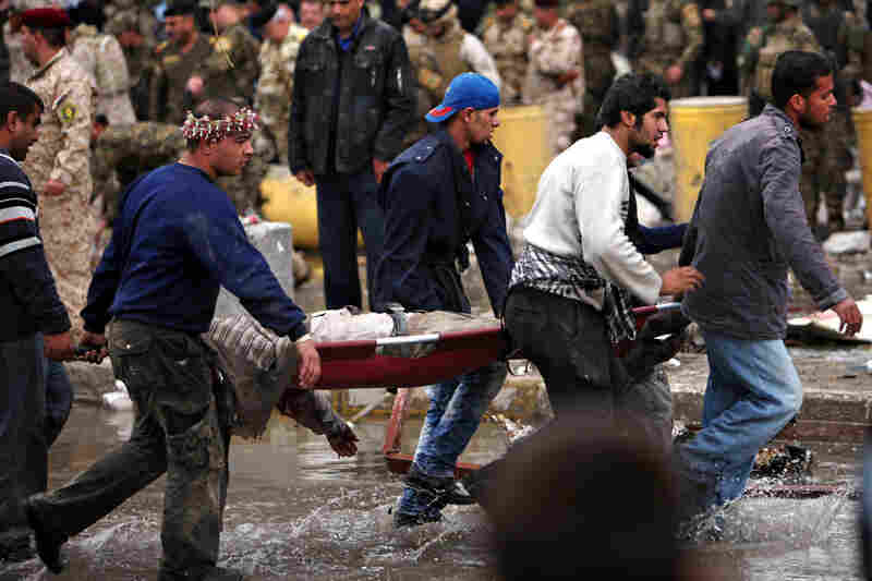 Rescuers evacuate the body of a victim killed by a bomb attack near the Finance Ministry. The previous Finance Ministry building was heavily damaged by a pair of car bombs in August.