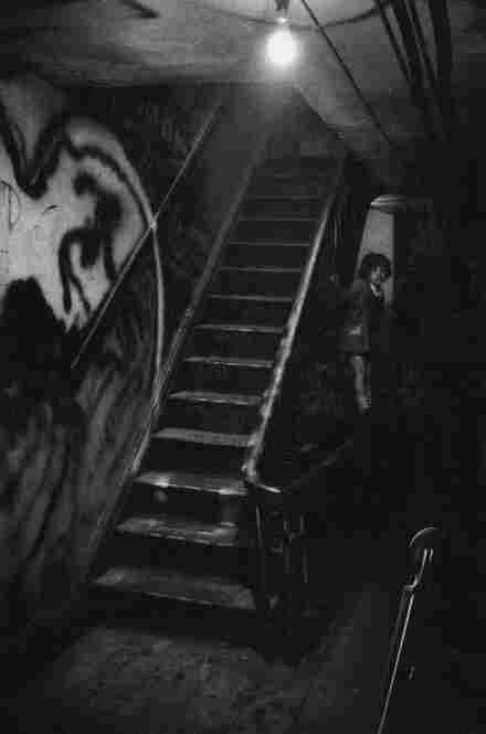In addition to snapshots of jazz greats, Smith caught quieter moments of his cats and his children — like this image of his daughter Shana climbing the stairs.