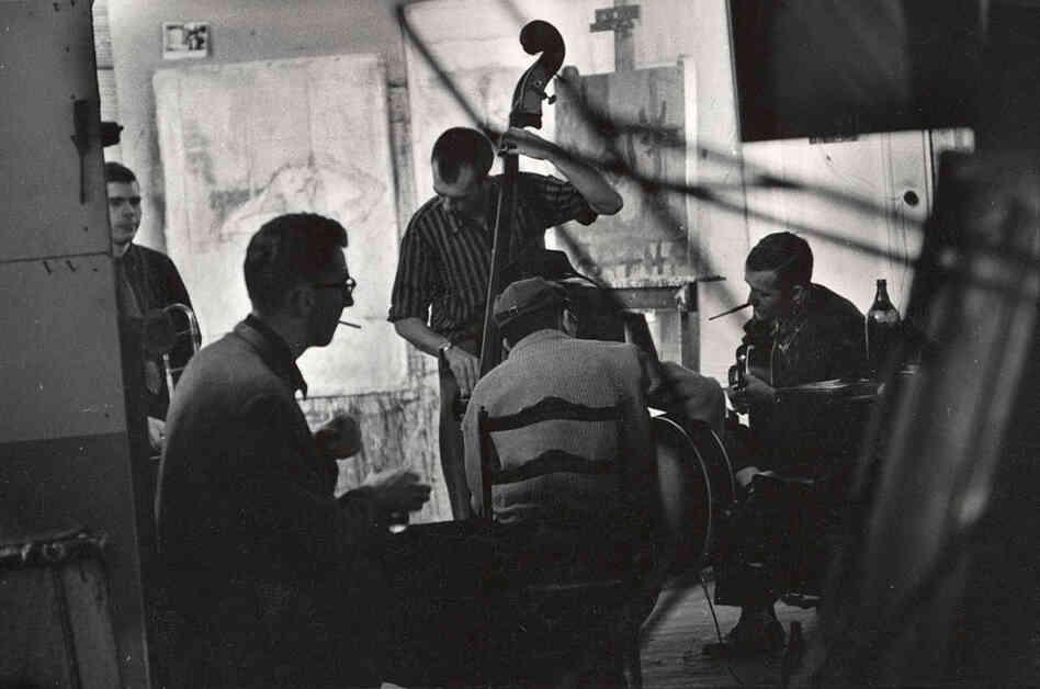 (From left) Bob Brookmeyer (trombone), Lee Konitz, Bill Crow (bass), Jim Hall (guitar) and Jimmy Raney (guitar) jam at Smith's loft.