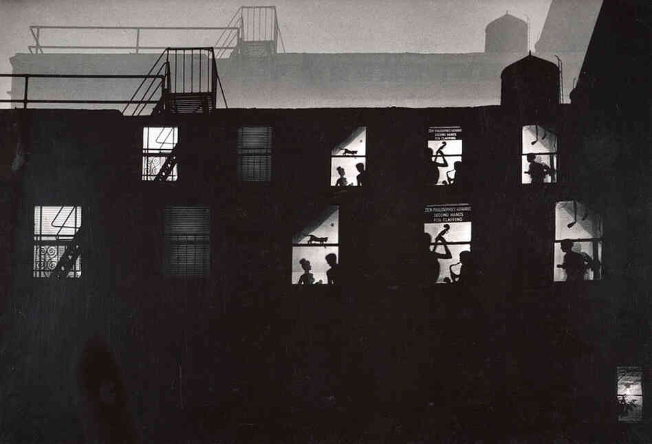 A double-exposed image shows photographer W. Eugene Smith's loft in lower Manhattan, a late-night hangout for the city's artists and jazz musicians in the 1950s and '60s.