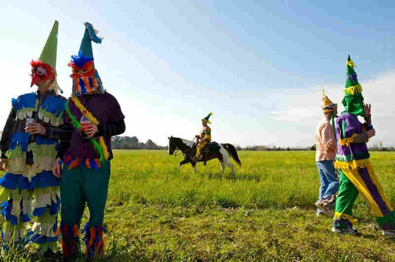 At a Cajun Mardi Gras celebration in rural Louisiana, festival-goers dance, drink, and parade through the countryside in traditional costumes collecting ingredients for a large gumbo.