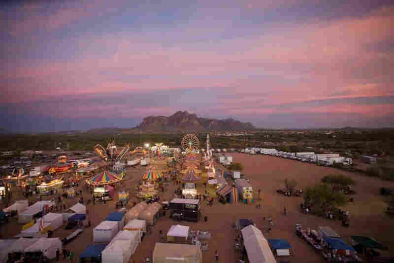 Superstition Mountain in the distance at Lost Dutchman days rodeo in Apache Junction, Ariz.