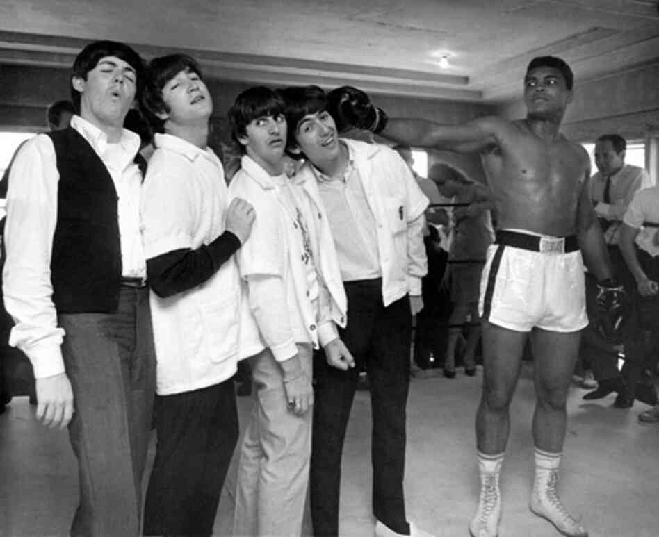 "Benson was assigned to photograph The Beatles before they made it huge. ""I turned on the television in my room and saw Cassius Clay yelling. ... And I thought that would make a good picture, so I suggested to The Beatles that we go meet Clay."" The Beatles with Cassius Clay, Miami, 1964"