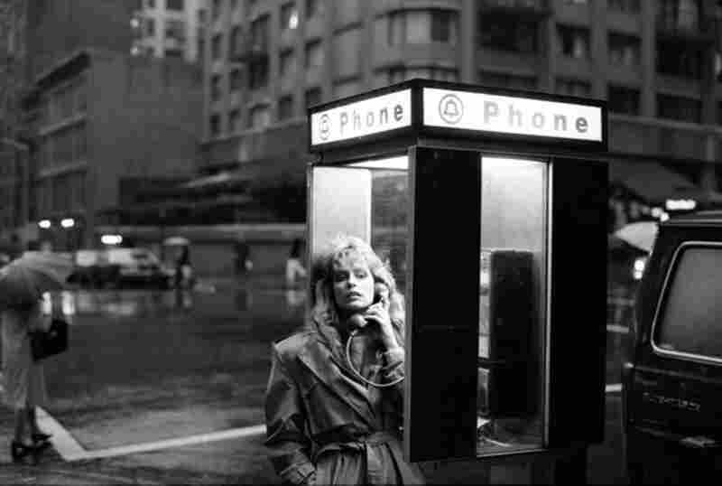 """Benson photographed Farrah Fawcett after she had risen to fame with the television hit Charlie's Angels. """"She knew exactly how she wanted to look and she looked great. ... It was beginning to get dark and starting to rain. I asked her to stop at the phone booth on the corner of my block."""" Farrah Fawcett, New York City, 1981"""
