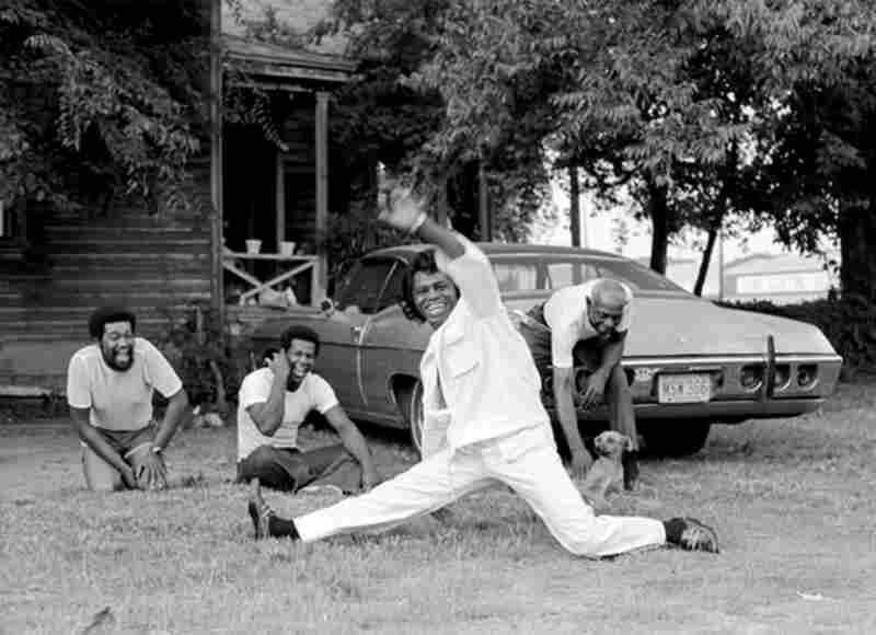 """Benson photographed James Brown in Augusta, Ga., in 1979. """"He told me he would show me 'his town'. ... He would stop the car when he saw someone sitting in their yard, run up, do the split, yell out, 'I feel good,' and jump back in the car and drive off."""" James Brown, Augusta, Ga., 1979"""