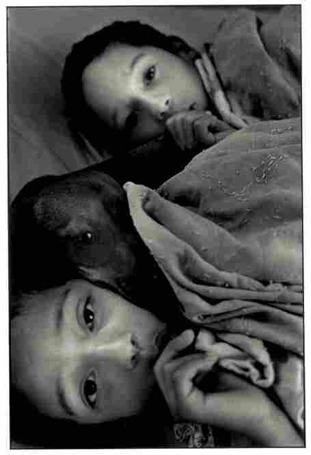 This is the last photo Bazan took in Cuba.  His twin boys are in bed with their dog, contemplating leaving the island the next day.