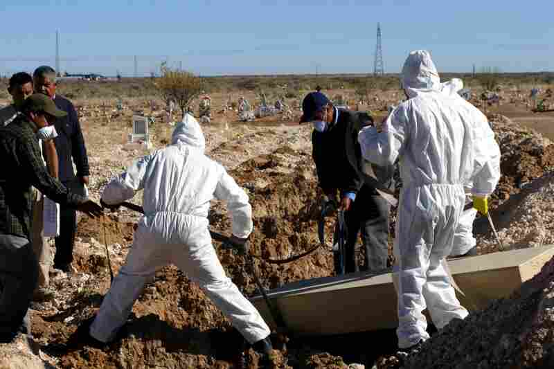 City workers this month bury 26 unidentified corpses from the Juarez morgue. More than a hundred bodies, mostly of young men, were left unclaimed this year.