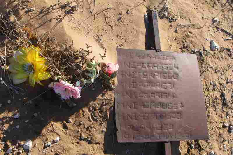 Simple signs mark the fosa comun, or paupers' grave, where unclaimed bodies are buried.