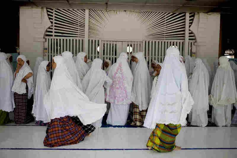 Students prepare to pray in a mosque at their state Islamic boarding school, which offers a national and Islamic curriculum.