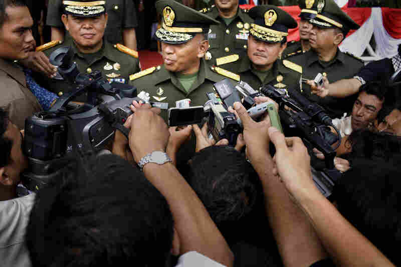 Indonesia's Army Chief of Staff, Gen. George Toisutta (center), speaks to local media about the handover from Gen. Soenarko (right) to Gen. Hambali Hanafiah (left).